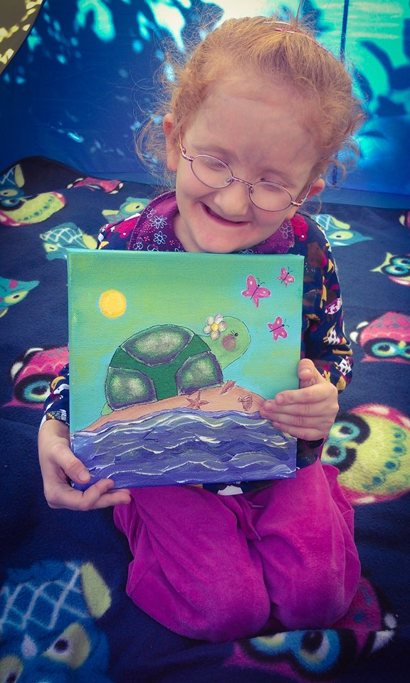 Julie with her painting 1